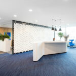 Front desk reception wall Facet in width 646cm x height 265cm and color White
